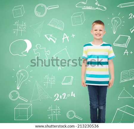 happiness, childhood, school, education and people concept - smiling little boy in casual clothes over green board with doodles background - stock photo