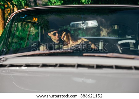 Happiness couple in the car