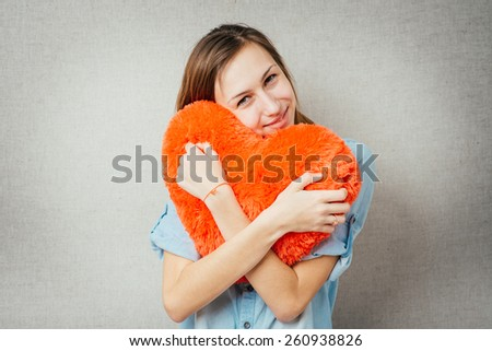 happiness, cute girl with a big heart and soft hands - stock photo