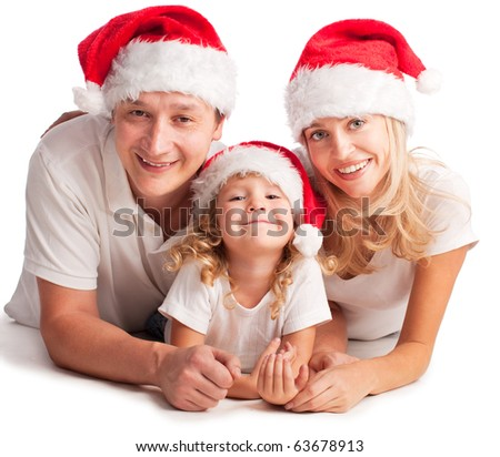 Happiness family in christmas hat isolated on white - stock photo