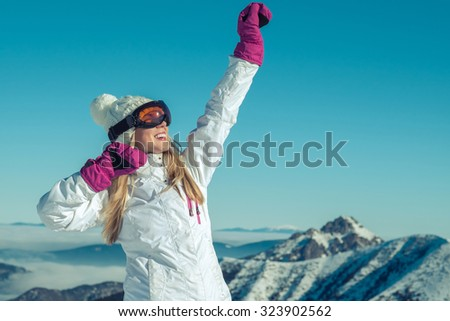 Happiness female stay on the top of mountain with beautiful view - stock photo