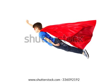 happiness, freedom, childhood, movement and people concept - boy in red superhero cape and mask flying in air - stock photo