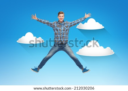 happiness, freedom, movement and people concept - smiling young man jumping in air over blue sky with white clouds background - stock photo
