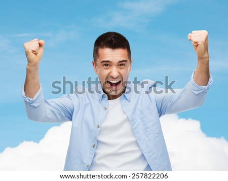 happiness, gesture, emotions and people concept - happy laughing man with raised hands over blue sky and cloud background - stock photo