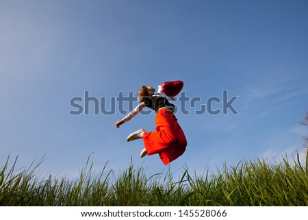 Happiness girl in jump - stock photo