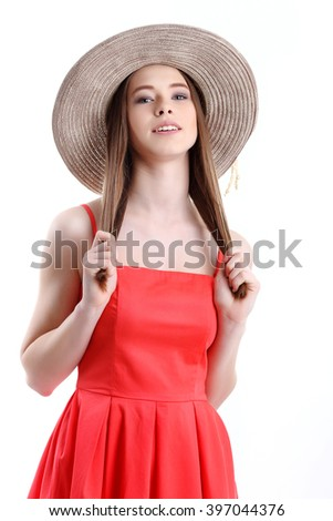 Happiness. Happy summer woman isolated in studio. Energetic fresh portrait of young woman excited cheering in wearing beach hat - stock photo