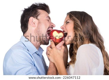 Happiness, health and love concept. Smiling couple with apple heart, isolated on white background - stock photo