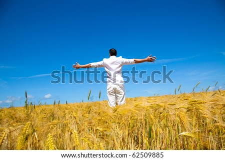 Happiness in golden summer corn field - stock photo