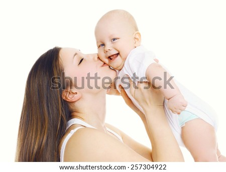 Happiness mother! Young mom kissing her cute baby - stock photo