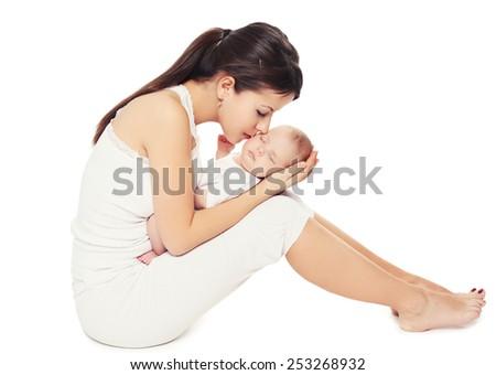 Happiness of mother - sleeping sweet baby lying on hands mom - stock photo