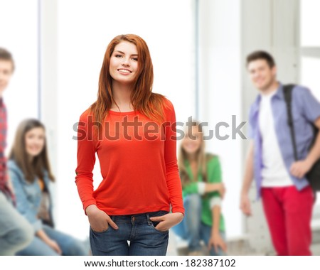 happiness, school, education and people concept - smiling teenager in casual top and jeans at school