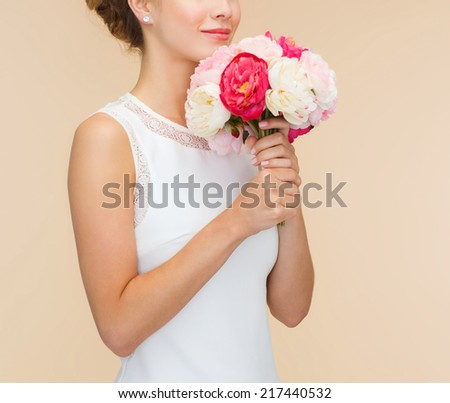 happiness, wedding, holidays and celebration concept - smiling bride or bridesmaid in white dress with bouquet of flowers - stock photo