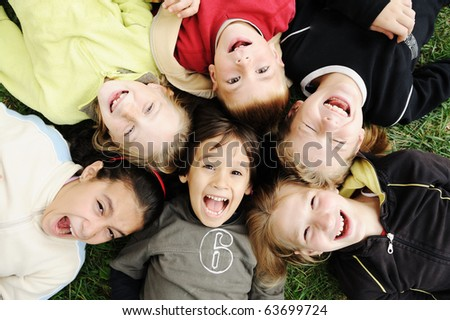 Happiness without limit, happy group of children in circle, together outdoor, faces, smiling and careless - stock photo