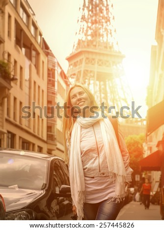 Happiness Woman on the street in Paris under sunlight - stock photo