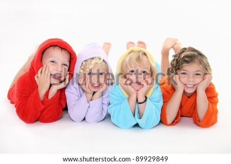 Happpy children in bathrobe - stock photo