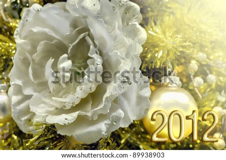 Happy 2012 a festive decoration for a happy new year in white and gold with flower - stock photo