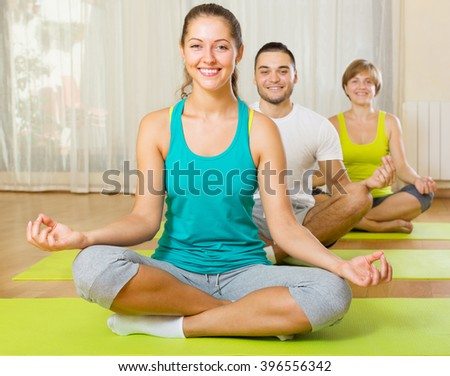 happy active at group people yoga practice in fitness club