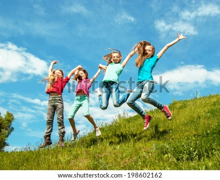 Happy active children jumping - stock photo