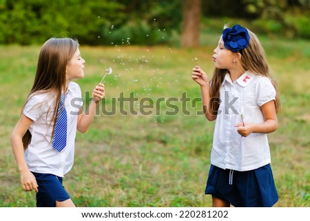 Happy active children playing in the  park after school - stock photo