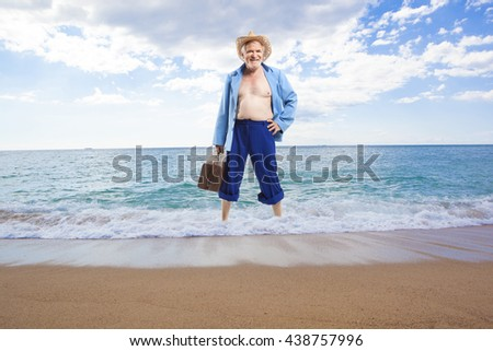 Happy active elderly man on the background of the sea on the beach - stock photo