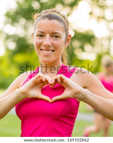 happy active girl making a heat gesture after her cardio workout - stock photo