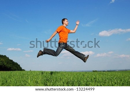 Happy active man walking on the air jumping high at the  blue sky background