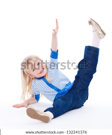 Happy adorable baby girl having fun; active child playing on white background - stock photo