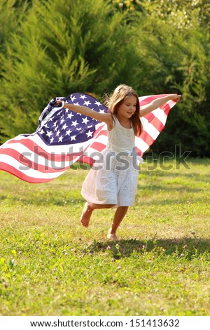 Happy adorable little girl smiling and waving American flag outside/Smiling child celebrating 4th july - Independence Day - stock photo