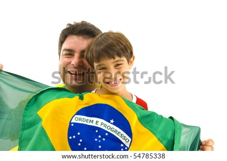 Happy Adult and child holding a brazilian flag . - stock photo