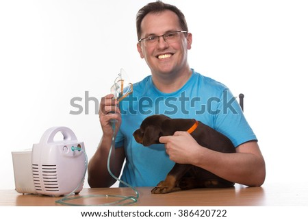 Happy adult doctor using nebulizer mask for respiratory inhaler dog Treatment isolated on a white background - stock photo
