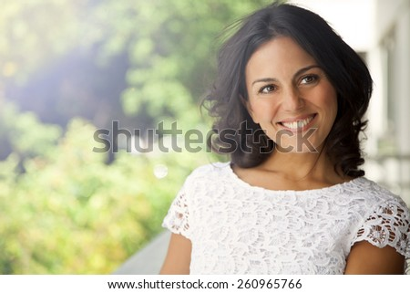 Happy adult woman outdoors - stock photo