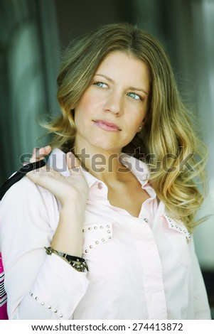 Happy adult woman with shopping bag - stock photo