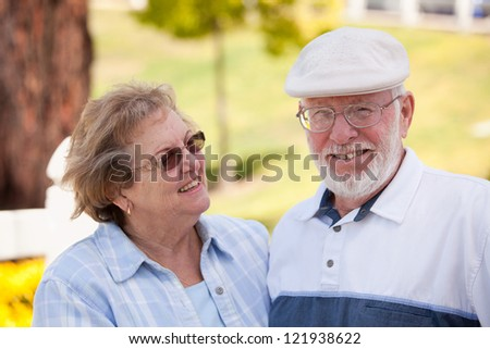 Happy Affectionate Senior Couple Enjoying Each Other in The Park. - stock photo