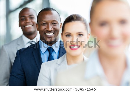 happy african american businessman standing in a row with colleagues