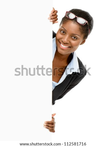 Happy African AMerican businesswoman holding white billboard isolated on white background - stock photo