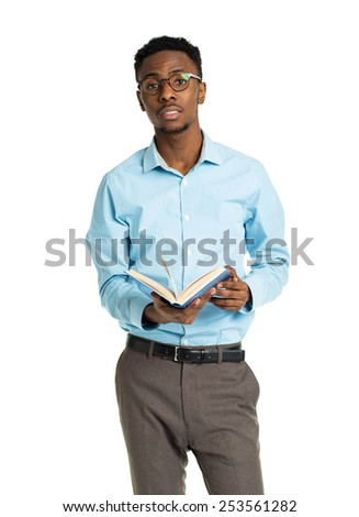 Happy african american college student standing with book in his hands on white background