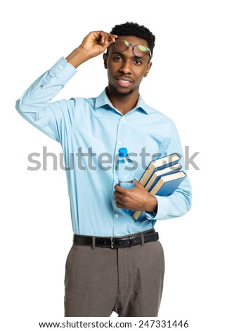 Happy african american college student standing with books and bottle of water in his hands on white background - stock photo
