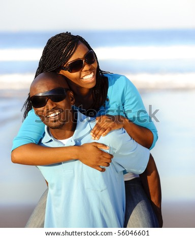 Happy African American couple enjoy the beach