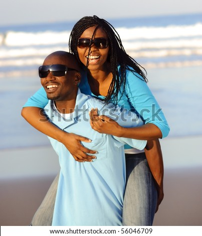 Happy African American couple enjoy the beach - stock photo