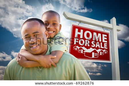 Happy African American Father with Son In Front of Home For Sale Real Estate Sign and Sky. - stock photo