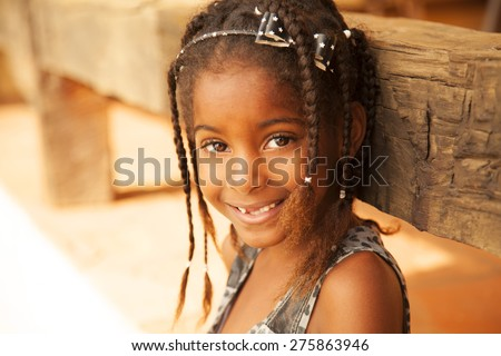Happy african american girl smiling and looking at camera - stock photo