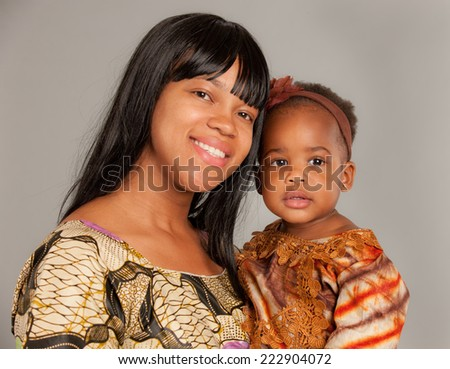 Happy African American Mother Holding Baby Girl Portrait Isolated on Grey Background - stock photo