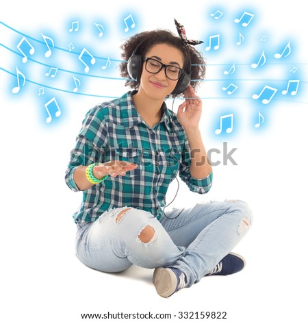 happy african american teenage girl sitting and listening music isolated on white background - stock photo