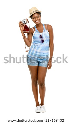 happy African American woman tourist holding vintage camera isolated on white background