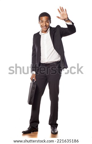 Happy african businessman waving his hand - stock photo