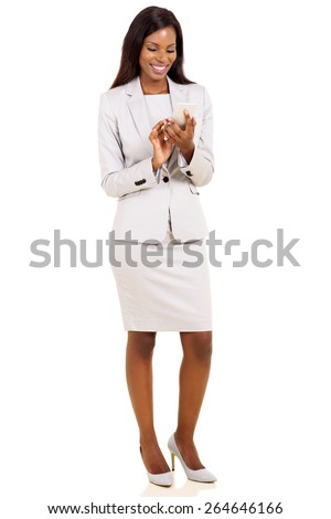 happy african businesswoman texting on her smart phone - stock photo