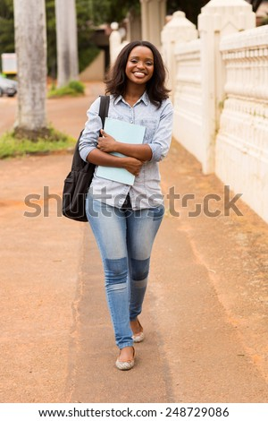 happy african college girl going to school - stock photo
