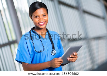 happy african doctor using tablet computer - stock photo