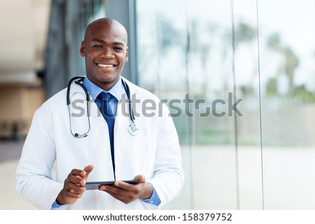 happy african male doctor with tablet computer - stock photo