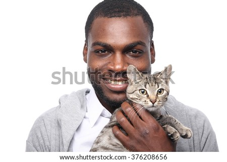 Happy african man with cat - stock photo